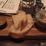 Bread with honey butter and pickled vegetables served at seating
