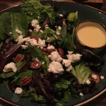 Greens salad with goat cheese, blueberries and pecans