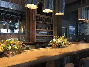 Reclaimed and industrial bar at Vita Vite art gallery + wine bar in Downtown Raleigh